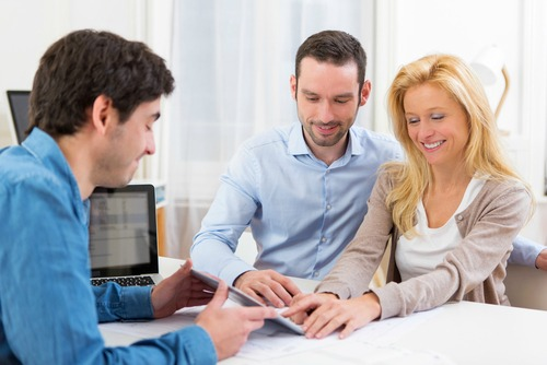 man and woman with real estate agent
