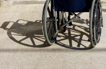 Handicap access and picture of a wheelchair - Photograph by Ze'ev Barkan